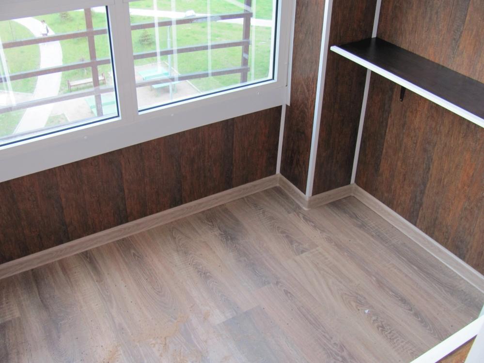 Балкон, отделанный панелями мдф