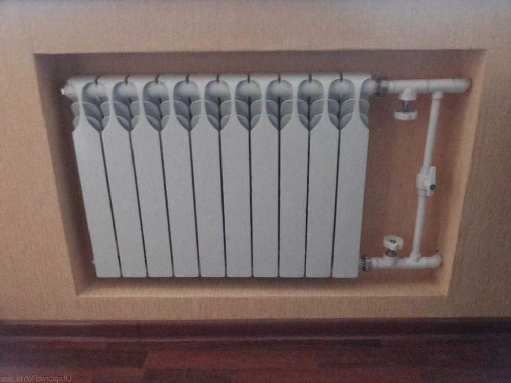 Необычный радиатор, который украшает интерьер небольшой квартиры